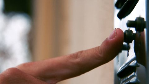 Hand Of A Male Ringing A Doorbell Of A Residence On A Sunny Day.