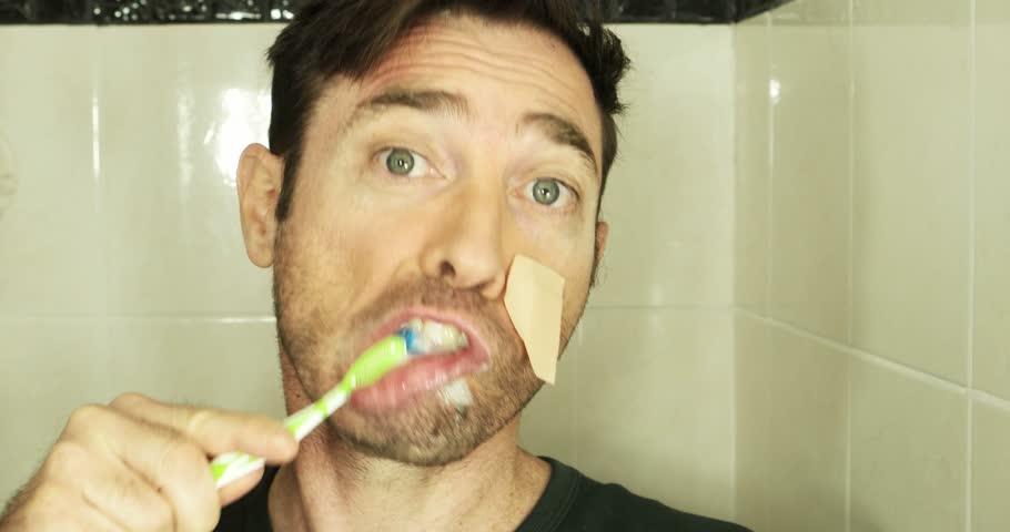 Handsome idiot brushing teeth