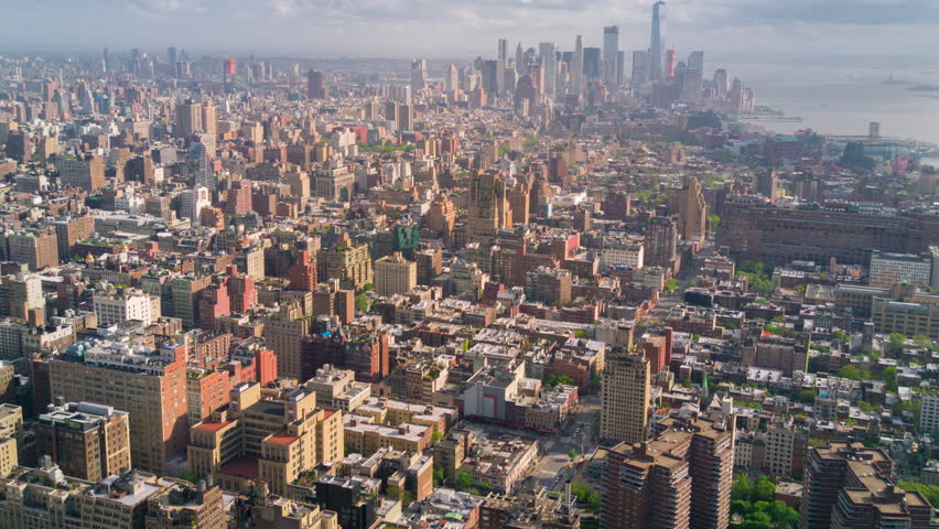 Aerial view of Manhattan, New York City. Tall buildings. Sunny day, aerial timelapse dronelapse. Clouds on background. | Shutterstock HD Video #1012402214