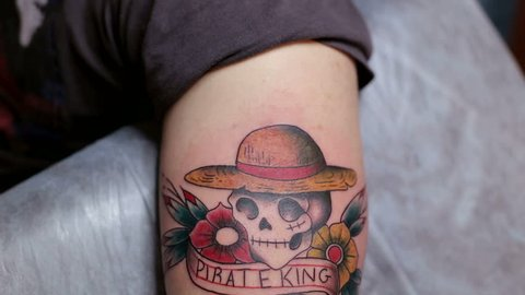 Close-up of a tattoo with a skull on the hand of a man. Tattoo parlor. Tattoo.