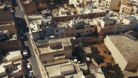 Aerial drone shot flying backwards over Marsaxlokk in Malta