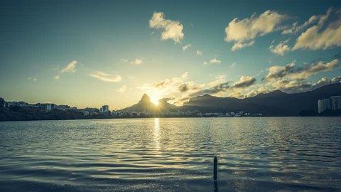 Sunset over Rio De Janeiro Mountains and Lagoa Rodrigo de Freitas Lake , Brazil. Timelapse with vintage colors