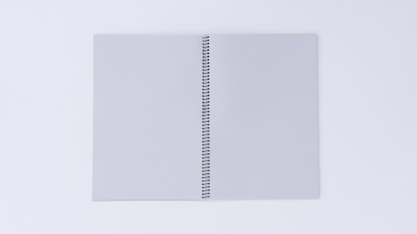 Turning page by the wind on a white background