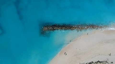 Drone stationary aerial of jetty in Grace Bay, Providenciales, Turks and Caicos
