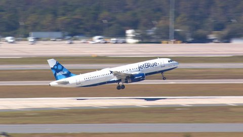 ORLANDO, FL - 2018: JetBlue Airbus A320 Jet Airplane Taking into a Sunny Day Blue Sky from MCO McCoy International Airport in Central Florida