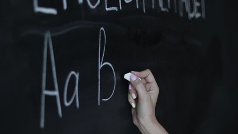 Education concept - ABC alphabet school blackboard concept. School teacher writing ABC alphabet in English class or preschool.on chalkboard.