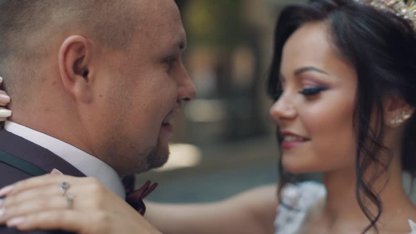 Lovely wedding couple making a kiss | Shutterstock HD Video #1012519094