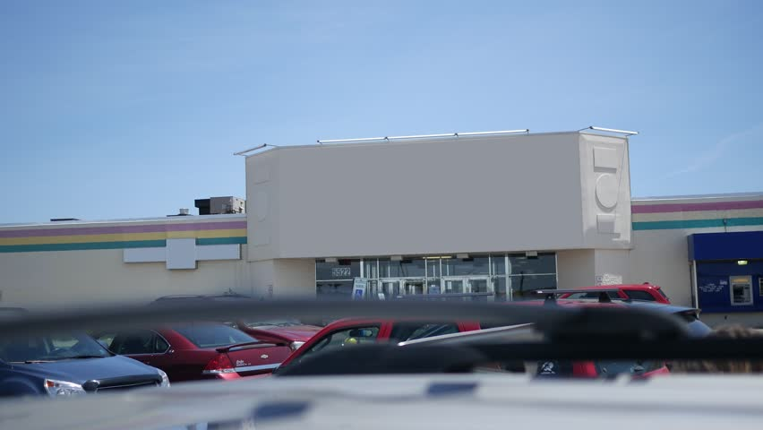 A daytime establishing shot of a blank mall style building entrance