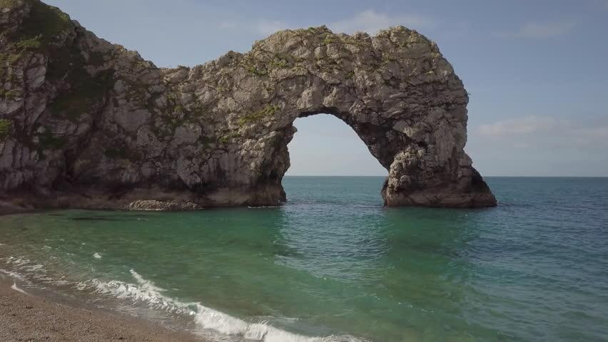 Durdle Door rock formation, Jurassic Coast, Dorset, UK | Shutterstock HD Video #1012550654