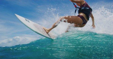 Beautiful young woman kitesurfing in the ocean