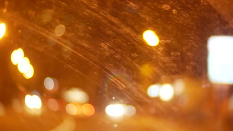 car window night background defocus in motion, through the dirty window of the car, withered dirt stains after the rain. 4k