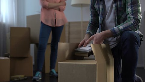 Wife nervously waiting while her unfaithful spouse taking things and moving out