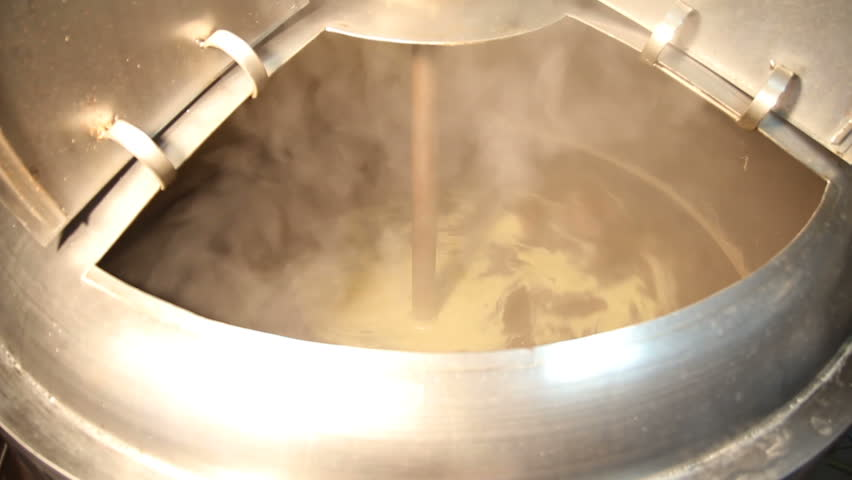 Brewing. Beer in the tank for brewing whirls in a whirlpool, mixed. The process of making beer.