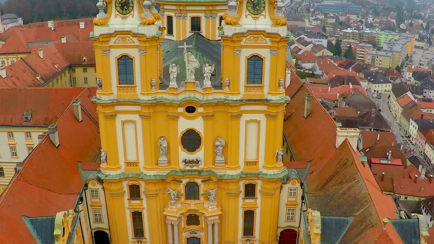 Old facade and roofs of Melk monastery in Austria, tourist attraction, aerial