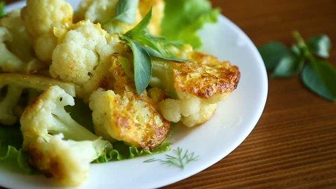 cauliflower fried in batter on a plate