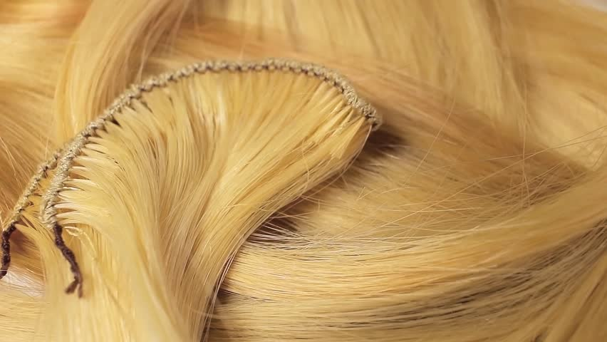 Hair extension cutted hair fibers blonde weft rotating pattern macro texture background backdrop footage video. | Shutterstock HD Video #1012748084