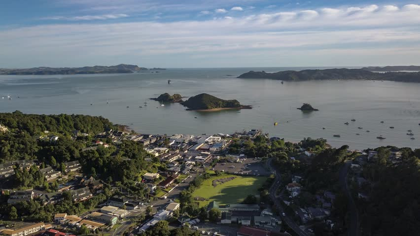 Beautiful bay of islands in New Zealand, Paihia town. Time lapse in early morning showing boats traveling across bay. | Shutterstock HD Video #1012827194