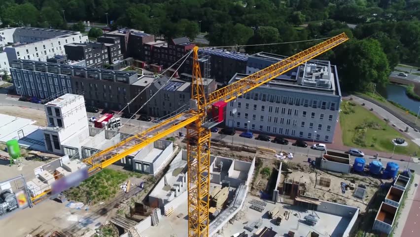 Aerial flight around tower crane a modern form of balance crane that consist of basic parts fixed to ground on concrete slab tower cranes often give the best combination of height and lifting capacity
