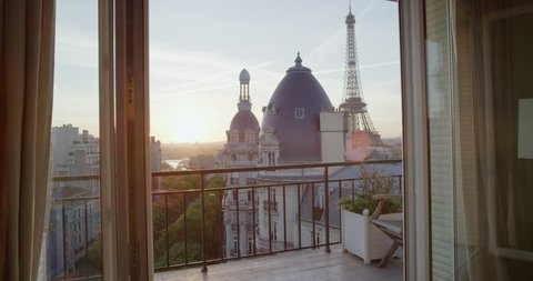 view of paris eiffel tower beautiful sunset over romantic french city on luxury apartment balcony travel vacation concept