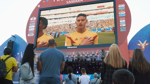 SAMARA - JUNE 28, 2018: Football fans watching the game on large screen at the official FIFA FAN FEST zone. World Cup 2018 on June 28, 2018 in Samara, Russia.