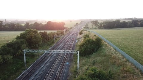 West Coast railway; Virgin trains travelling through the English countryside on a summer's evening. Hanslope junction.