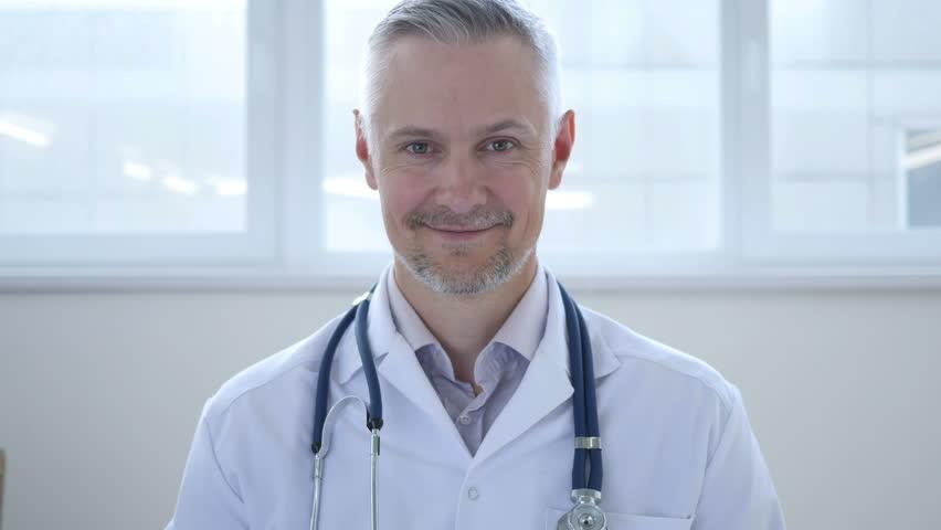 Portrait of Smiling Doctor | Shutterstock HD Video #1013000534