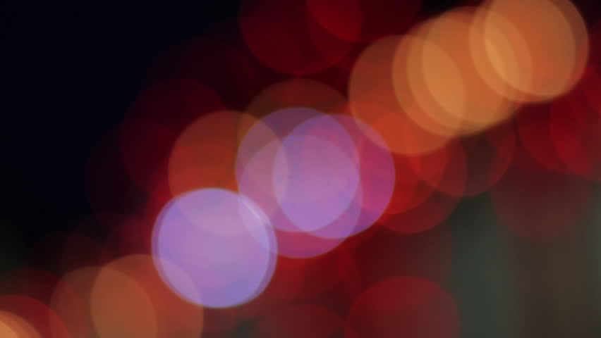 Red, orange and white lights flashing and creating an abstract blurry pattern. Pretty background design element with bokeh lights. Decorative neon lights out of focus.  | Shutterstock HD Video #1013075144