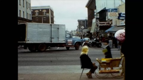BERKELEY, CALIFORNIA/USA - CIRCA 1968: Town scenes of Berkeley, California with people, traffic and store fronts. Part 1 of 2.