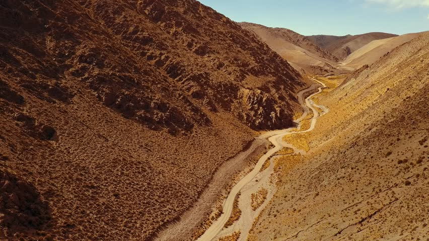 Slow aerial drone shot flying through the valley next to the Polvorilla Viaduct in Argentina