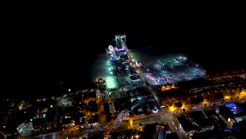 Aerial view of the beach in Santa Monica, CA in 4K from a helicopter at night | Shutterstock HD Video #1013109704