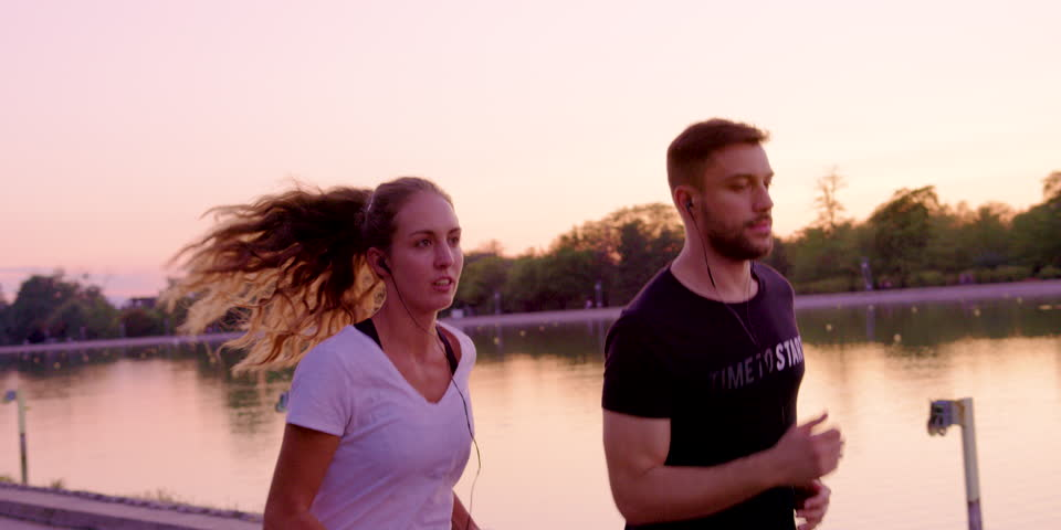 Couple Runners Jogging Listening to Stock Footage Video (100% Royalty-free)  1013188334 | Shutterstock