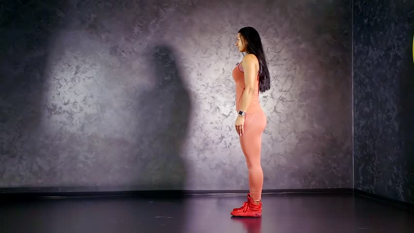 Young girl athlete performs an exercise flapping her legs forward . target muscle group quadriceps and press. comfortable sprative clothes | Shutterstock HD Video #1013204384