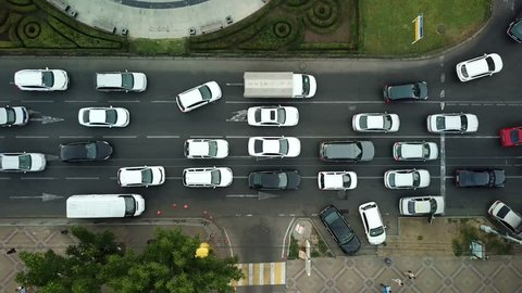Summer 2018 aerial drone footage of rooftops and streets in the center of Krasnodar city, Russia. Top down view of traffic jam.