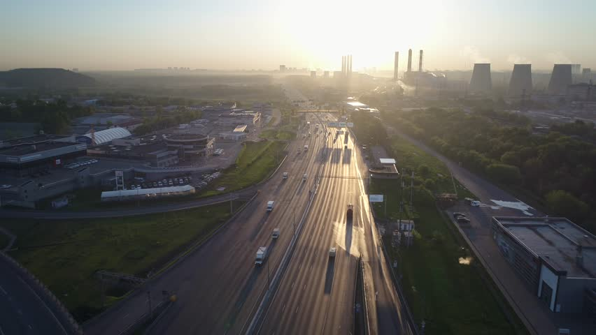 Aerial view. Flight over a huge highway of the Moscow ring road in the early morning at dawn. Highway are free for them moves few cars. Urbanistic scenery. | Shutterstock HD Video #1013265914