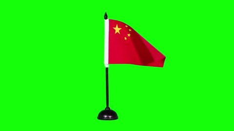 Slow motion of China flag waving on green screen background in the studio