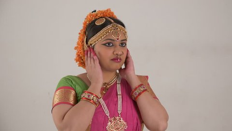 Indian girl showing different moods using traditional Bharat Natyam dance form. Fear expression.