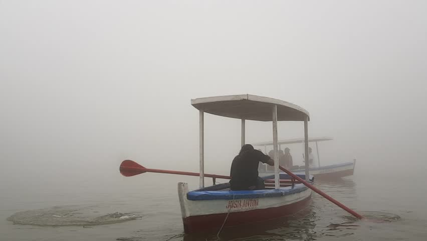 A lake filled with fog in the afternoon. The footage shows boats going into the fog and disappearing from sight. This was taken in a lake in Baguio, Philippines.