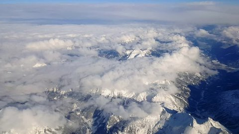 Flying in an Airbus A-320 over the snow covered Austrian Alps in Tirol region early December 2017.