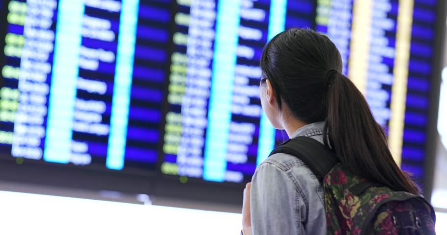 Woman checking the flight number in the airport | Shutterstock HD Video #1013481164