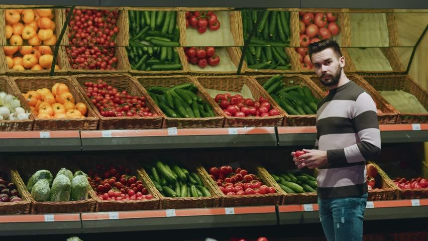 Man; male; shop; store; grocery; groceries; shopper; buyer; consumer; customer; supermarket; market; food; fresh; vegetables; vegan; sale; sales; retail; produce; fresh; vegetarian; lifestyle; vitamin | Shutterstock HD Video #1013491364