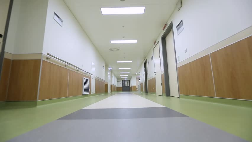Camera moves above the floor in the hospital corridor | Shutterstock HD Video #1013535074