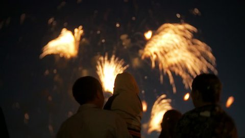 Unrecognizable family fireworks. People are watching fireworks 4k4k