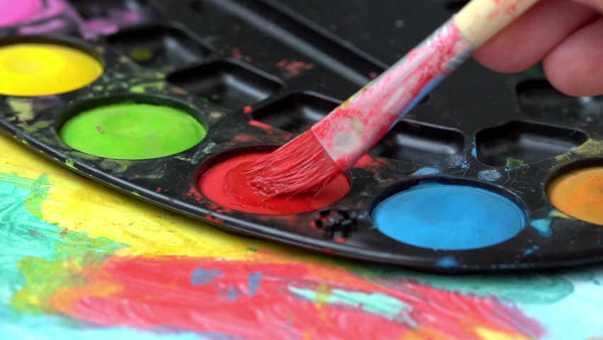 Brush taking red watercolor on color palette  | Shutterstock HD Video #1013598434