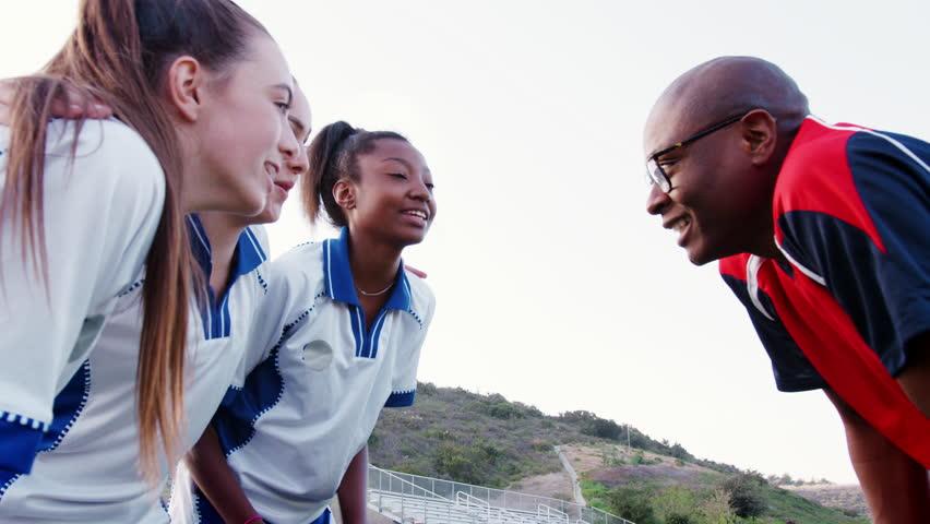 Female High School Sports Team And Coach Having Team Talk   Shutterstock HD Video #1013598674