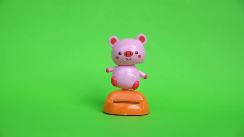 Pink pig doll dancing on green screen background. | Shutterstock HD Video #1013619164