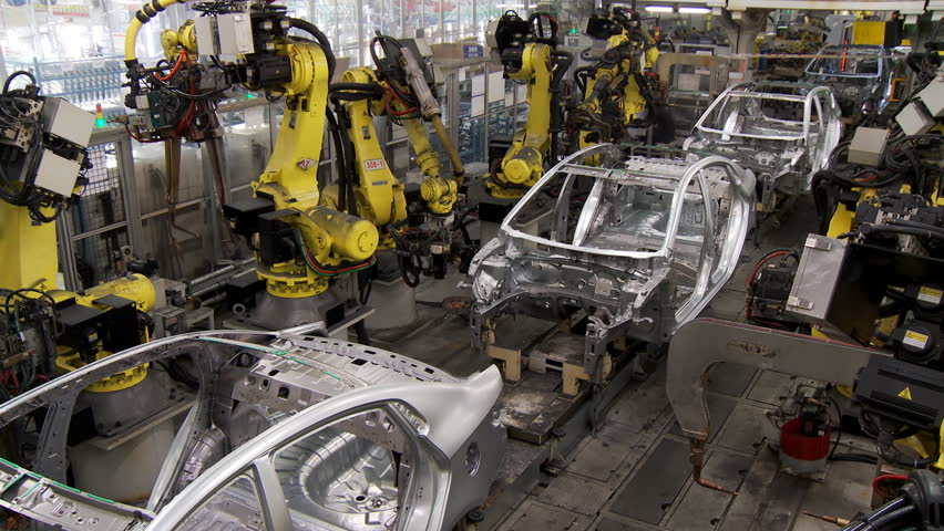 Robotic line at the automobile plant. Robot manipulators collect and weld car bodies | Shutterstock HD Video #1013631794