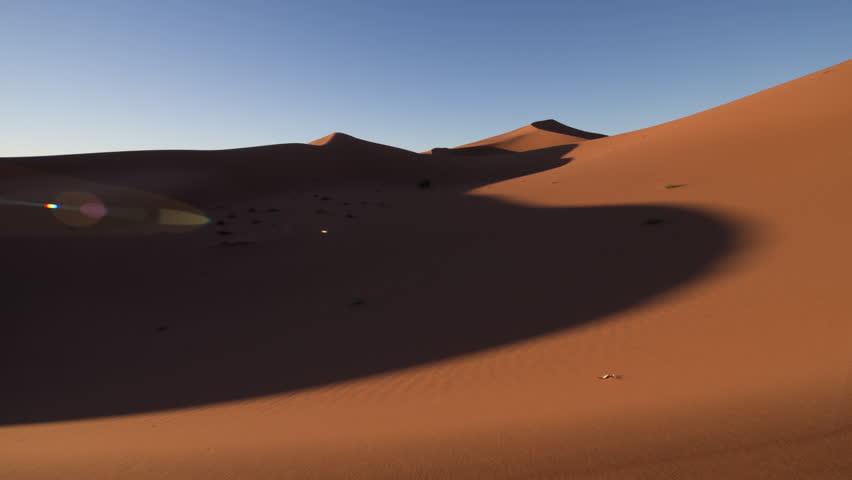 Timelapse of the amazing Erg Chigaga dunes in the sahara desert, morocco | Shutterstock HD Video #10136384