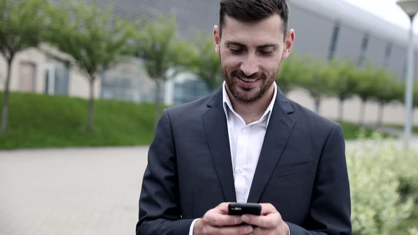 Close up view of Handsome Office Worker. Using Social Networks on his Smartphone.  | Shutterstock HD Video #1013642144