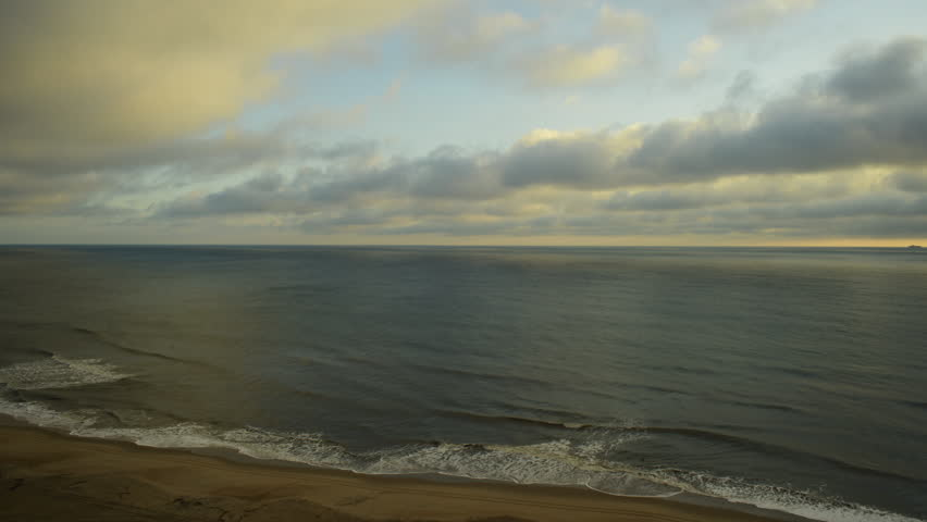 Time lapse of Atlantic Ocean from Virginia Beach, VA with moving clouds and waves