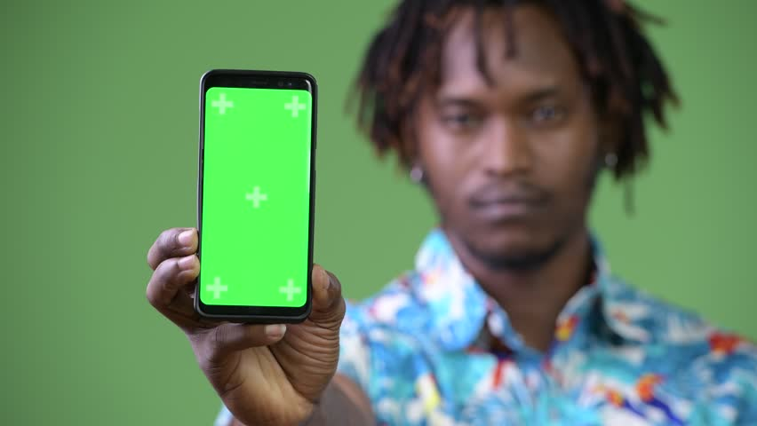 Young handsome African tourist man showing smart phone | Shutterstock HD Video #1013691344